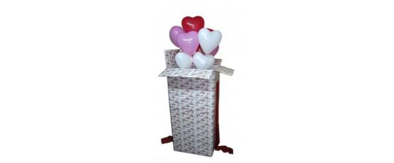 Balony wypełnione helem wypuszczane w powietrze z pudła. Wspaniała niespodzianka na ślub!